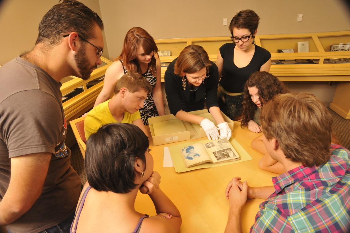 Students and instructor examining an artifact